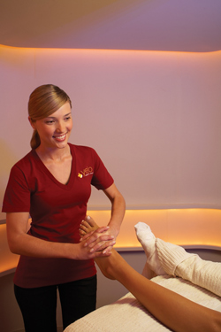 woman massaging foot