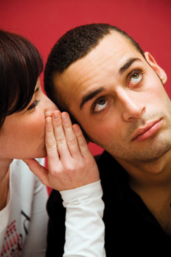 woman whispering in man