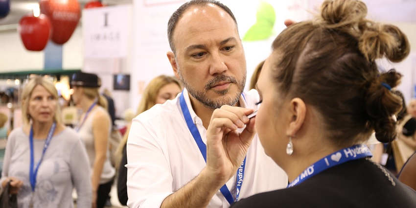 A person receiving lash treatment at Face & Body