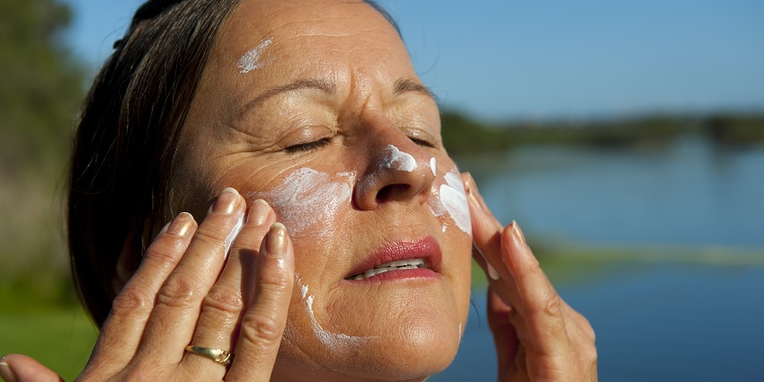 A person applying sunscreen