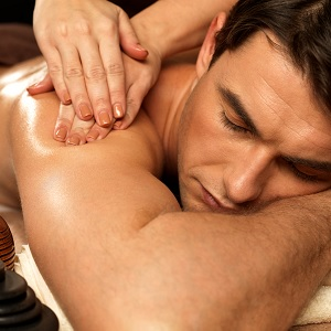Men receiving a spa treatment