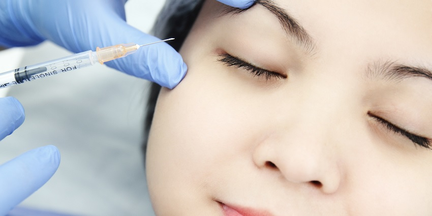 Someone receiving an injectable treatment