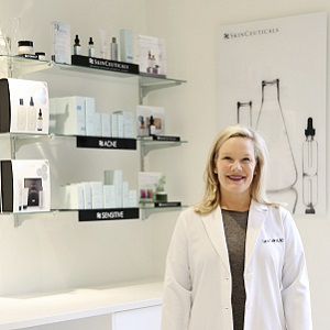 A dermatologist with skin care products