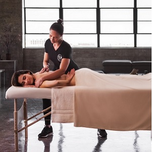 A person receiving a Soothe massage