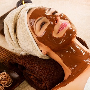 A lady receiving a chocolate treatment