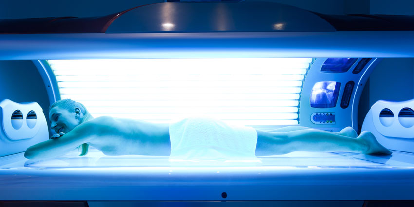Woman in tanning bed
