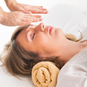 Person receiving a Reiki treatment