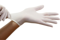 hands pulling on white latex gloves