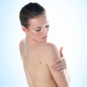 Woman looking at her back