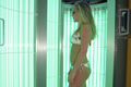 woman in tanning booth