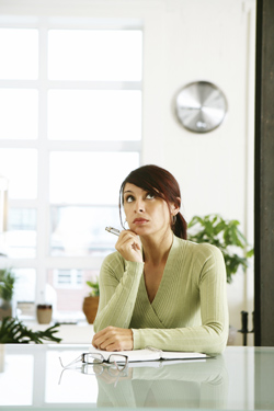 woman thinking in office